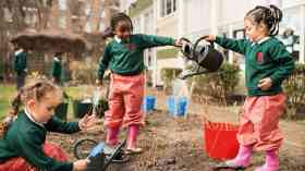 Griffin Primary School students watering trees