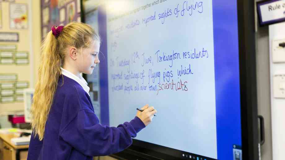 A Year 5 student using a Promethean ActivPanel at Torkington Primary School